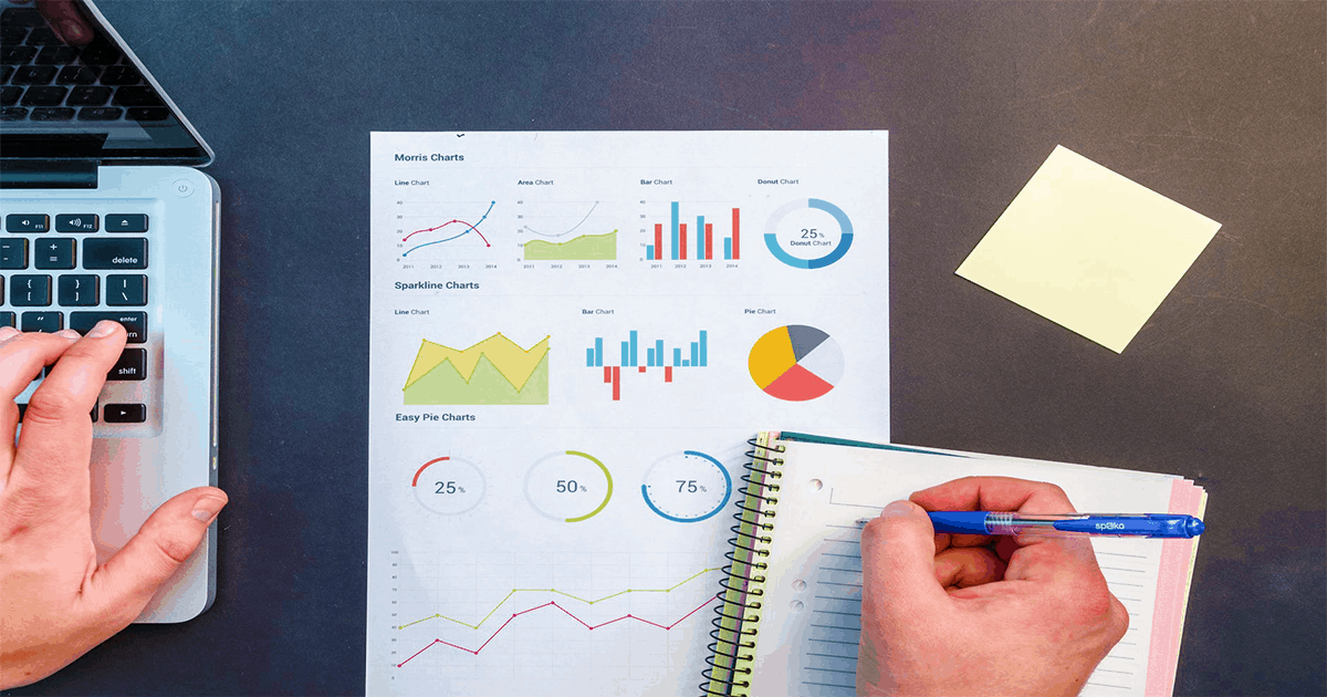 A person works diligently studying graphs and taking notes. Learn how to measure the efficiency of your marketing efforts by focusing on the data that means the most.