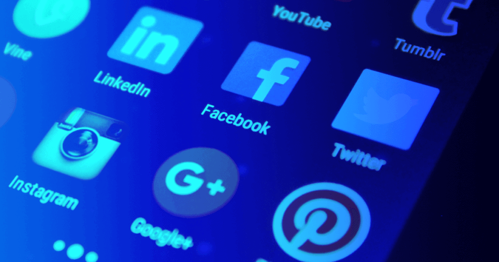 A closeup of a variety of social media apps on a smart device —social media tools are critical for businesses and social media managers who want to juggle the plethora of social media apps available in the modern age.