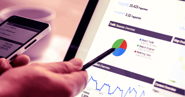 A hand with a pen pointing to a graph on a computer. SEO best practices aren't often as cut and dry as a graph and a list of data. Learn more.