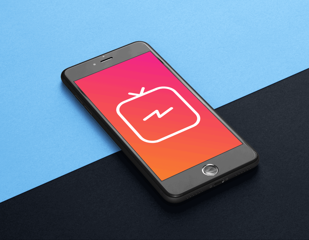 A black smartphone is lying on a blue and black background. The screen is red and displays a large TV icon. IGTV is a popular video application, and tips are available in this post.