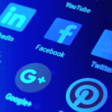A closeup of a variety of social media apps on a smart device — social media tools are critical for businesses and social media managers who want to juggle the plethora of social media apps available in the modern age.
